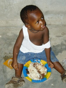 Liberian Boy with Rice & Beans
